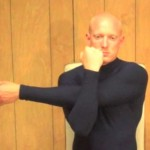 Folded Arm Stretch 150x150 List of Stretches and Routines