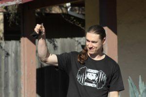 Logan Christopher holding a bent nail