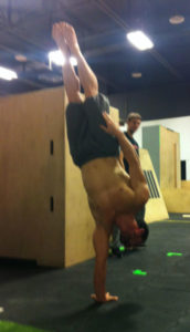 Thomas Tapp doing a single hand stand