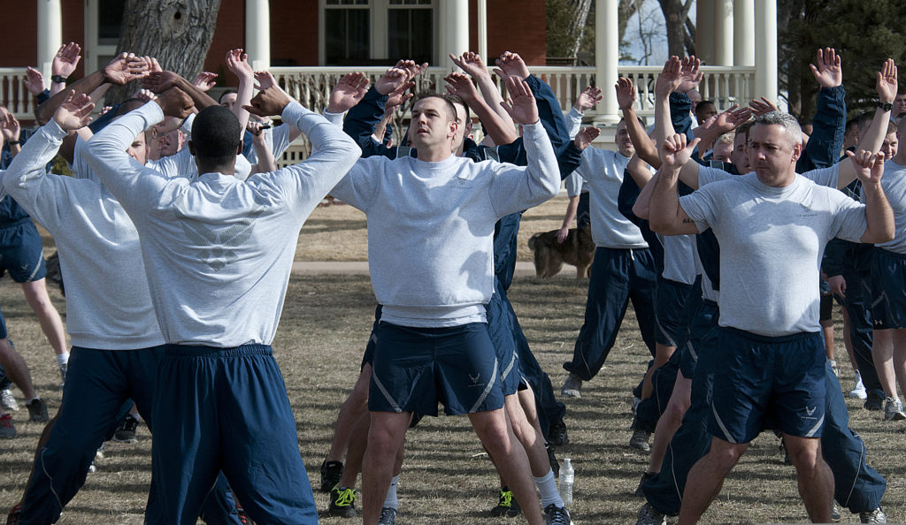 U.S. Airmen with the 90th Security Forces Group do jumping jacks before a two-mile pride run March 29, 2013, at F.E. Warren Air Force Base, Wyo. (U.S. Air Force photo by R.J. Oriez/Released)